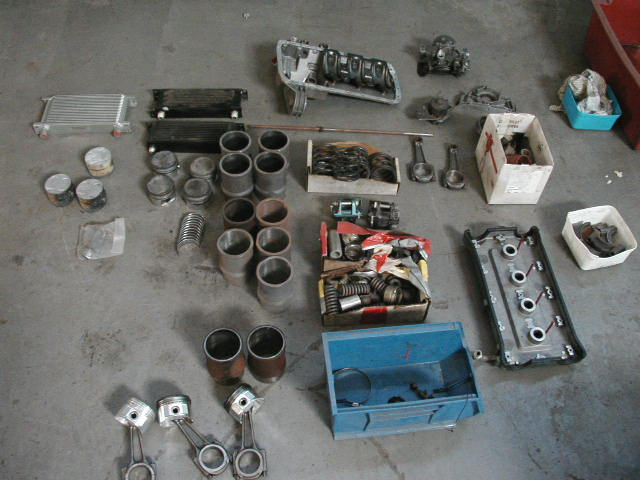 pistons,sleeves,oilcooler,camcover,shocksprings