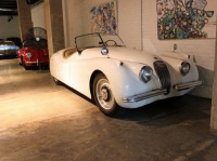 on-the-right-side-of-the-garage-was-another-jag-xk120-this-time-with-spats-over-the-rear-wheels-it-s