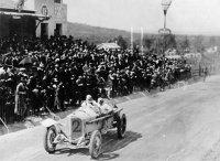 Christian Lautenschlager passing the tribunes in the Targa Florio race Sicily 1922. Driving a Merced