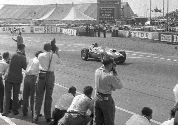 Silverstone 58 -  Peter Collins - Ferrari - crossing the finishing line