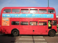 Route_13_Routemaster_outside_Golders_Green_tube_station_side_view